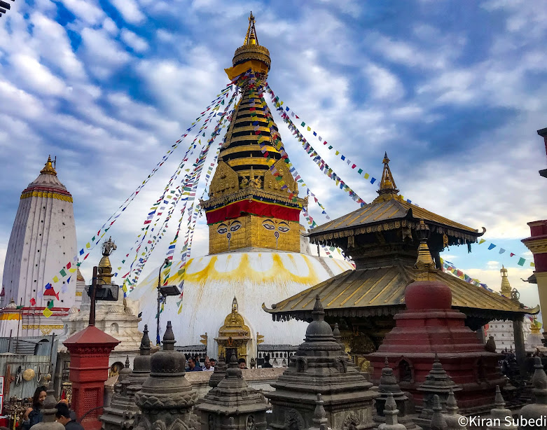 Swayambhunath stupa along with Harati Devi's temple and smalles stupas and pagodas in the foreground