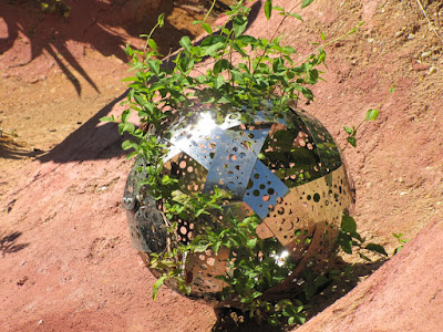 shiny metal ball in garden at the International garden festival at Chaumont-sur-Loire
