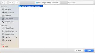 الضغط على زر الفتح في macOS