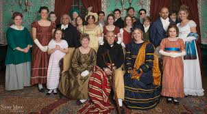 group of people dressed in period attire from the 1800's at Locust Grove historic home ballroom