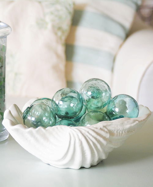 Decorative Clam Bowl filled with Glass Floats Decor Idea