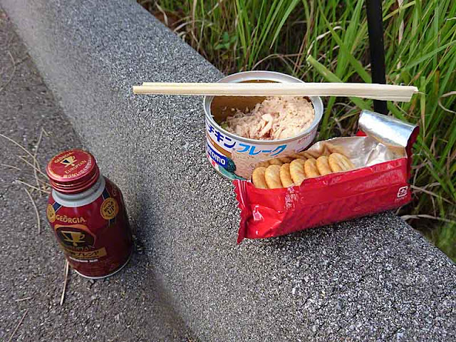 Can of iced coffee, tuna, Ritz Crackers, chopsticks