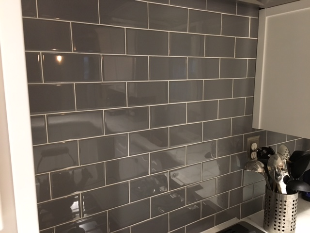 renovated kitchen, gray and white, gray subway tile