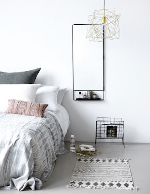Minimalist bedroom idea without side table