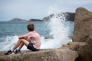 boy watching the ocean