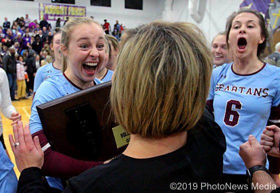 Jenna Albrecht and Lacey Kaiser share the thrill of victory with head coach Abby McDonald