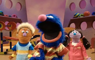 Grover's Fuzzy and Blue and Healthy Too show airs on the Happy Happy Healthy Monsters network. Grover has two assistant named Bobby and Sissy