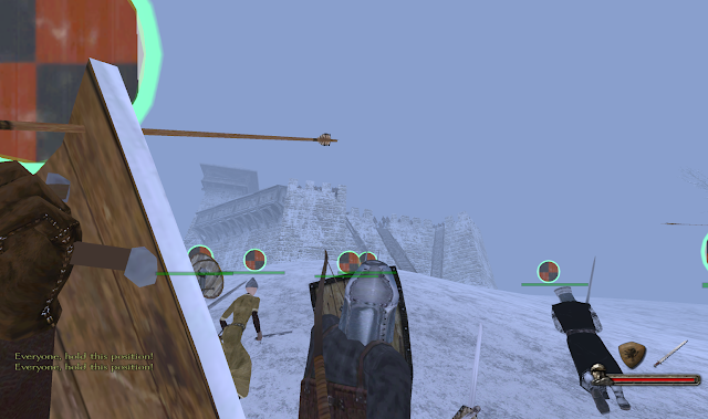 A siege battle in the snow from the game Mount and Blade