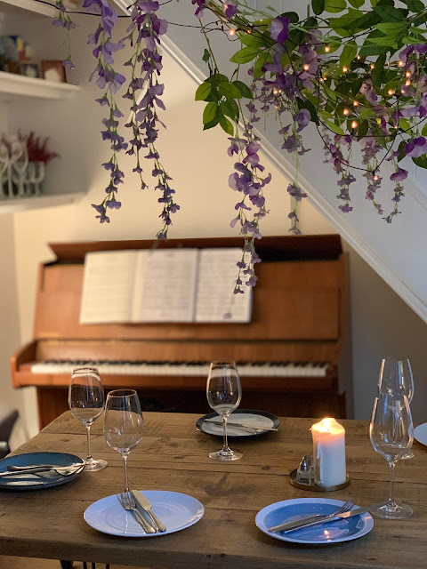 artificial wisteria over dining table