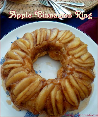 Apple Cinnamon Ring, a hot apple pie, cinnamon roll mash up. A beautiful dish that can be a breakfast, brunch, dessert or snack. | Recipe developed by www.BakingInATornado.com | #recipe #apple