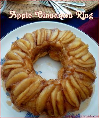 Apple Cinnamon Ring, a hot apple pie, cinnamon roll mash up. A beautiful dish that can be a breakfast, brunch, dessert or snack. | Recipe developed by www.BakingInATornado.com | #recipe #apple