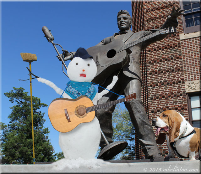 snowman with guitar, Elvis statue and Basset Hound