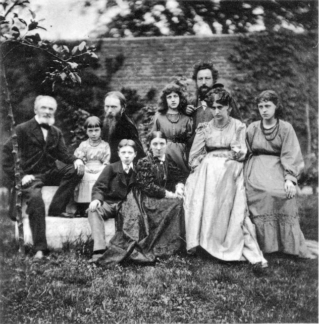 The families of William Morris and Edward Burne-Jones, photographed by Frederick Hollyer in the garden at The Grange, Burne-Jones's home in Fulham. Left to right: Edward Jones (Burne-Jones's father), Margaret Burne-Jones, Edward Burne-Jones, Philip Burne-Jones, Georgiana Burne-Jones, May Morris, William Morris, Jane Morris, and Jenny Morris. Platinotype photograph, 14 x 13.1 cm, 1874. Scanned from Linda Parry, William Morris, Abrams 1996