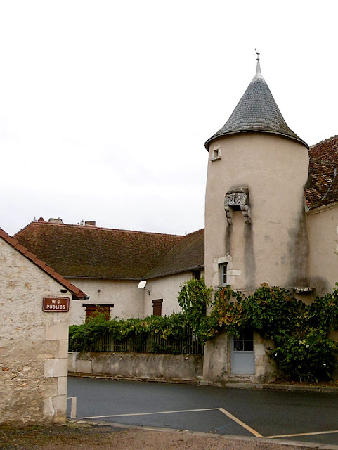 Medieval tower with jakes (toilet) next to modern public toilets, Indre, France. Photo by Loire Valley Time Travel.