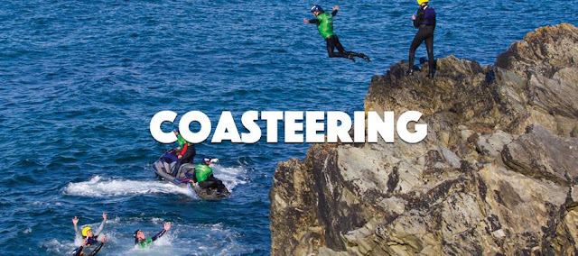 Man on a stag do jumping off a ledge whilst Coasteering