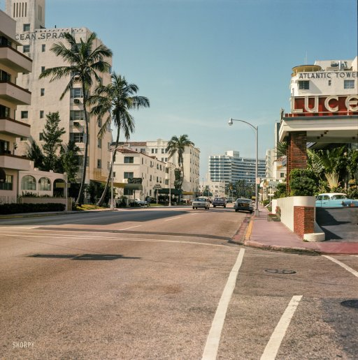 "1964. ""Collins Avenue, Miami Beach."" With the Ocean Spray Hotel representing  the Art Deco old guard and the curvy Fontainebleau the new. by Shorpy"