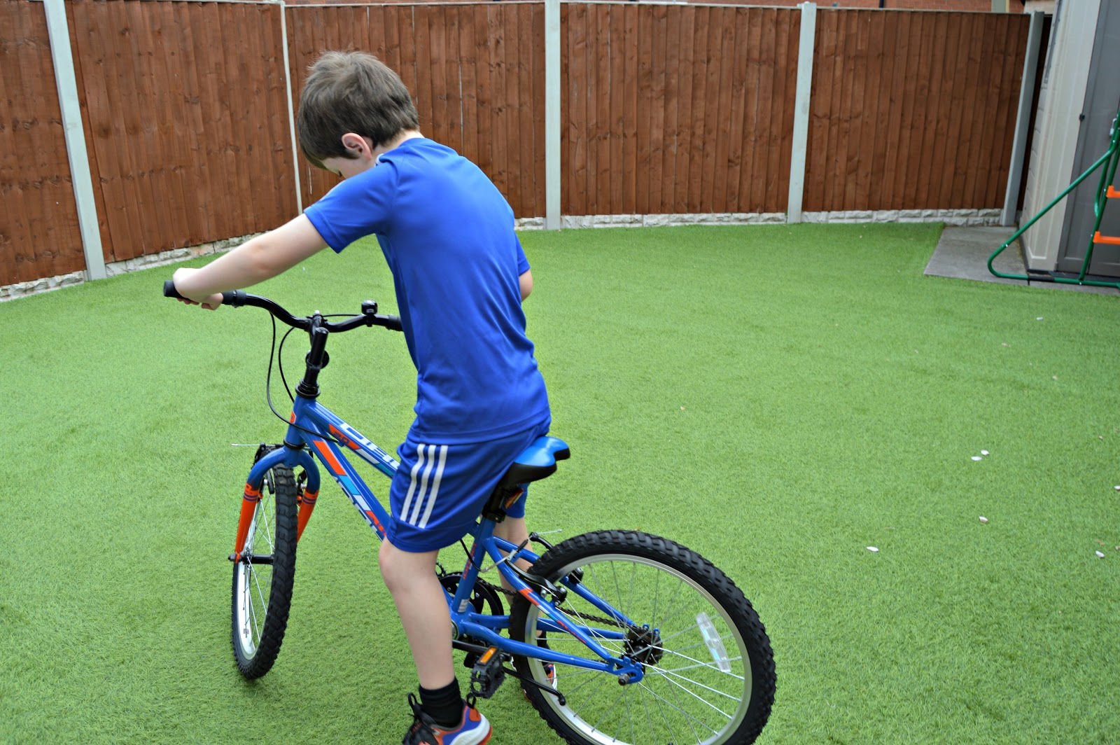 Boy practising on his bike