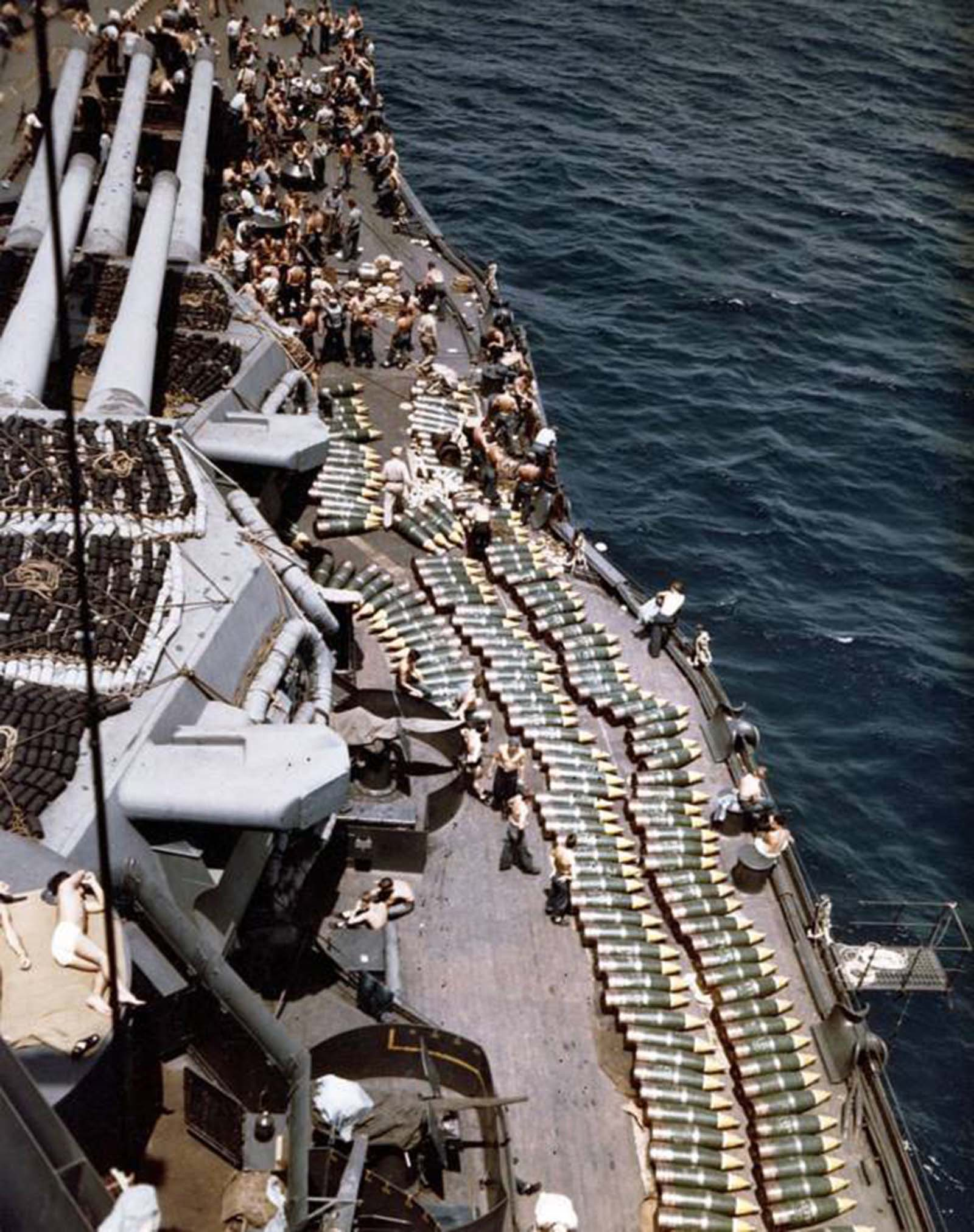 Troops and projectiles line the deck of the battleship USS New Mexico. Invasion of Guam, 1944.
