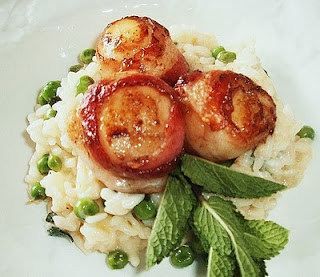 Seared Scallops Wrapped in Pancetta on a bed of Pea & Mint Risotto