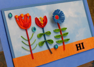 side view of brightly colored quilled floral card