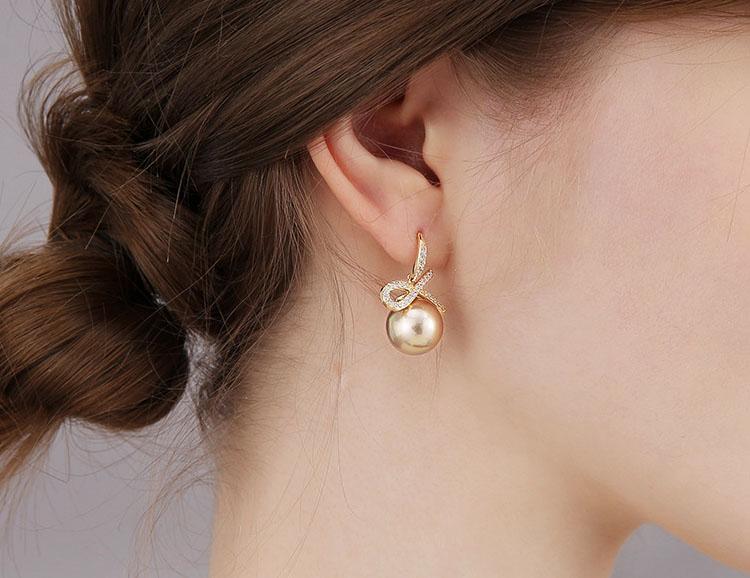 咖啡佳人擬珍珠蝴蝶結耳環