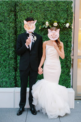bride and groom with cat face props