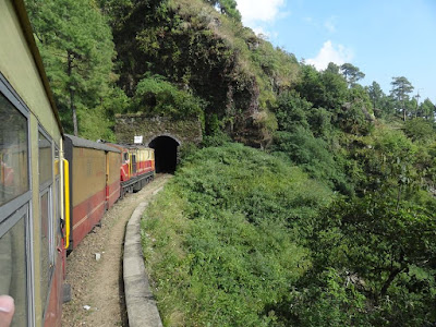 Toy train entering a tunnel