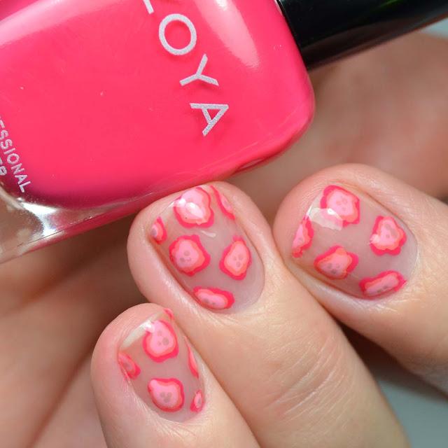 pink blobs of nail polish creating abstract floral nail art