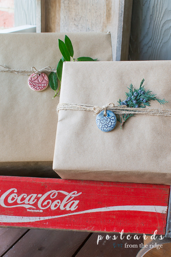 brown paper packages with glazed clay gift tags in coca cola crate wagon