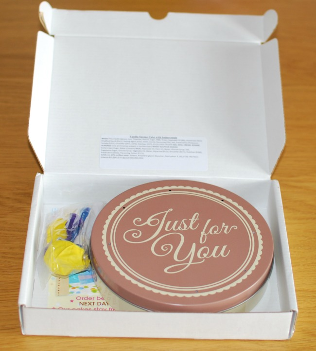 Bakers Day Letterbox Cake- Review tin and balloons in delivery box