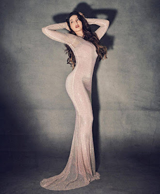 nora-fatehi-shows-off-her-curvacious-body-during-a-attractive-figure-hugging-robe