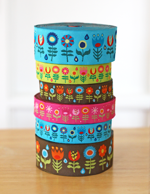 stack of bright floral jacquard ribbon