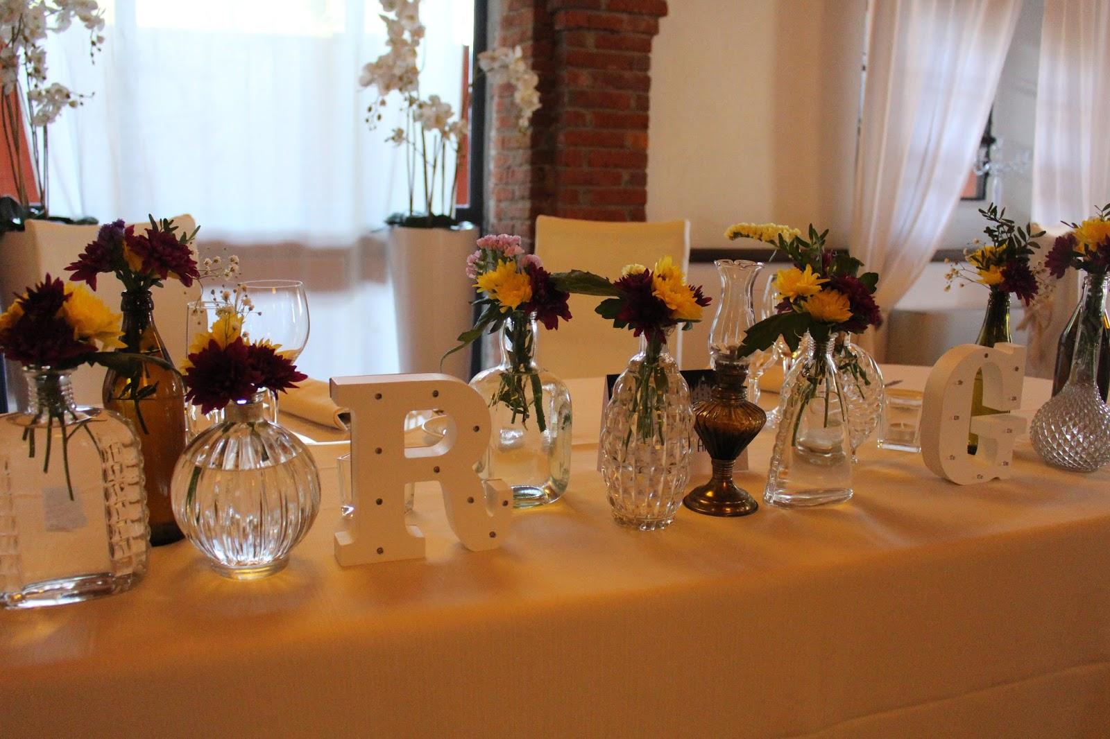 Come decorare tavolo sposi vasi di vetro