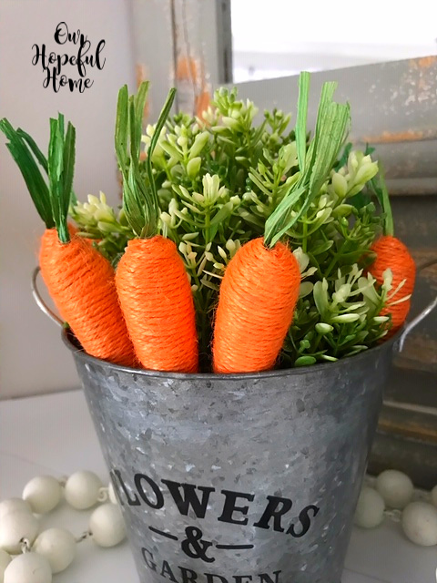 orange jute wrapped carrots metal bucket