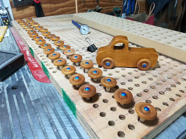 Wooden Toy Wheels Waiting For Glue To Cure In A Shop Made Jig