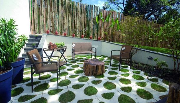 патио с бетонным мощением и зелеными островками