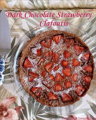 Dark Chocolate Strawberry Clafoutis is a beautiful light summer dessert. Whisk up the batter, top with fruit and bake. Serve warm, dusted with powdered sugar. | Recipe developed by www.BakingInATornado.com | #recipe #chocolate #dessert