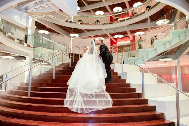 bride and groom walking in dr. phillips center
