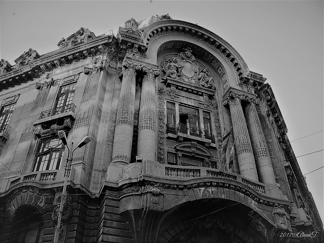 "In the old center. The Bourse Palace.  ""Palatul Bursei"" is a building in Bucharest, built between 1906 and 1912, according to the plans of the architect Ştefan Burcuş. In 1955 became the headquarters of State Central Library/ The National Library of Romania. In 2008 the building was returned to the owner of the law, Commerce and Industry of Bucharest. The one who first questioned the need to build a headquarters for the Bucharest Chamber of Commerce and Industry in a central area was King Carol I in 1904 at the suggestion of George G. Assan. The architect selected by the contest was Ştefan Burcuş, and the resistance structure was designed by the engineer Gogu Constantinescu, the bricks being able to withstand a load of 150 kg / cm2 and the floors to be made of reinforced concrete. The style is the neo-classical French with pilasters and corinthian columns. "" Source Wikipedia"