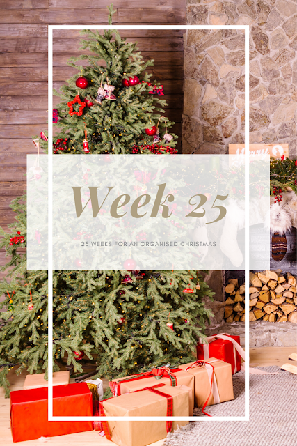 Festive scene with a tree and gifts with week 25 in text across the front