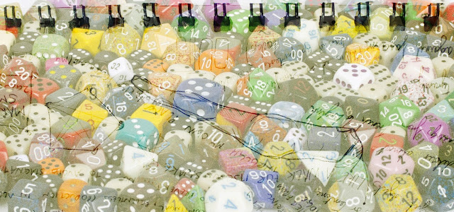 A picture of a lot of dice, including polyhedral dice.