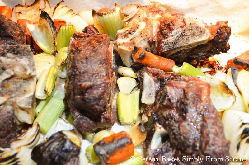 Roasted meaty beef bones and veggies for Homemade Beef Stock.