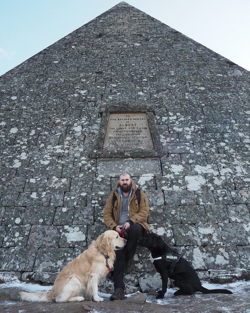 Gordon and the two dogs leaning against the Balmoral pyramid