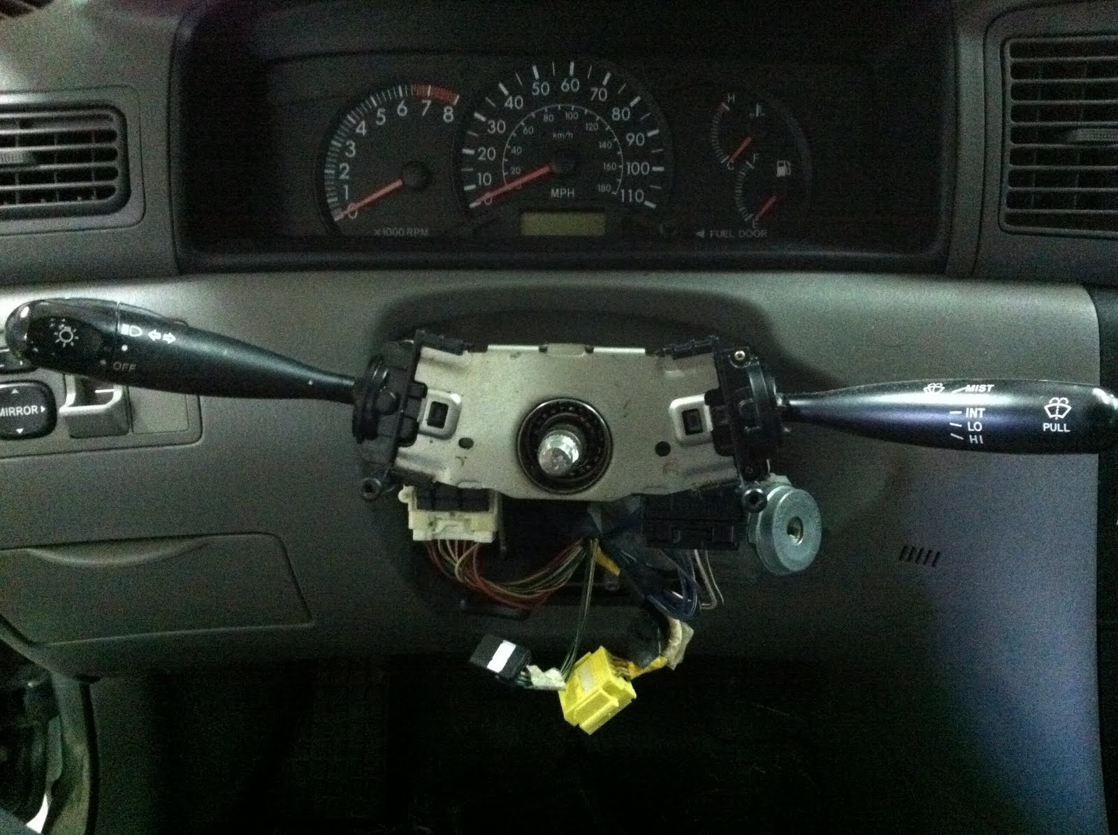 The final step to getting the old headlight switch out is to disconnect the  the wire harness connector to the headlight switch and disengage the  plastic ...