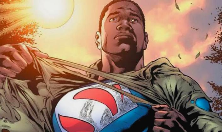 Imagem de capa: uma ilustração dos quadrinhos com o personagem Val-Zod, um homem negro com cabelos pretos cortados bem curtos, olhos pretos, rasgando um casaco marrom e revelando o uniforme do Superman com um símbolo vermelho sobre o azul, e por trás o Sol brilhando sobre ele.
