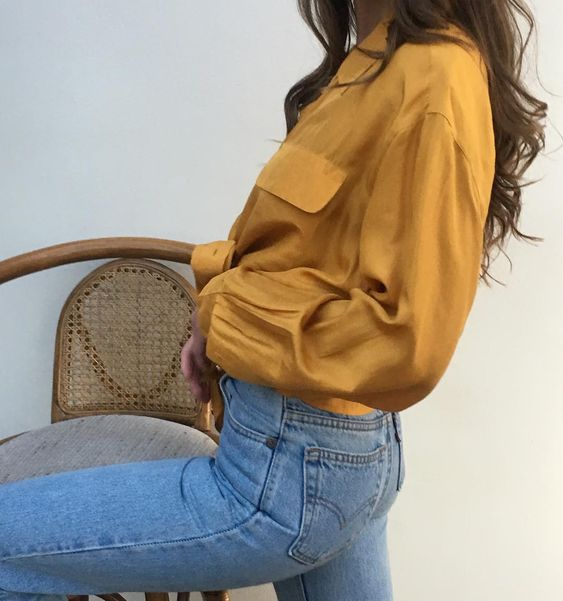 gold shirt and denim