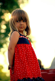 Girl Wearing a Red, White, and Blue Dress