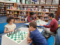 Kids playing chess at Kensington Park Library