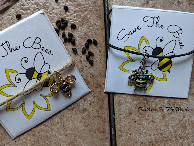 Save the bees seed packets with charm bracelets attached. Craft instructions.