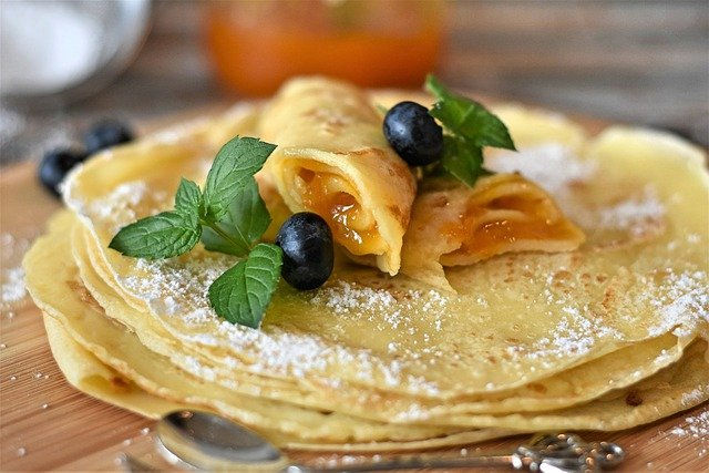 Thin pancakes with apricot filling